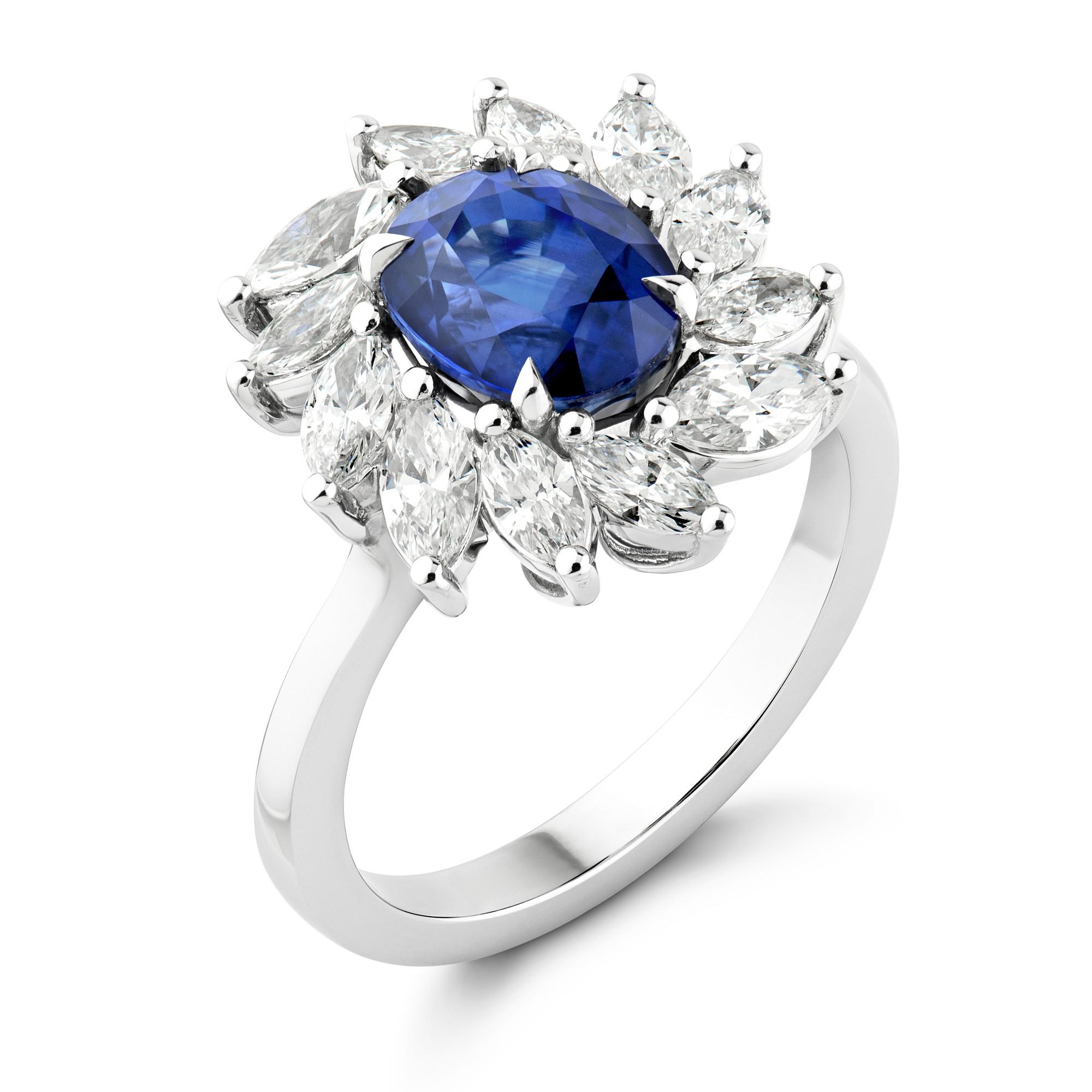 An Oval Cut Sapphire & Diamond Cluster