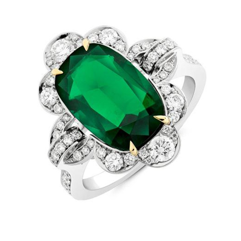 An Oval Cushion Cut Emerald Cluster