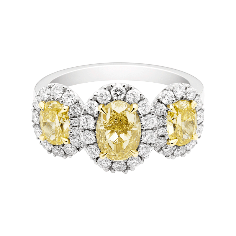 An Exceptional Yellow Diamond Oval Cut Three Stone Dress Ring