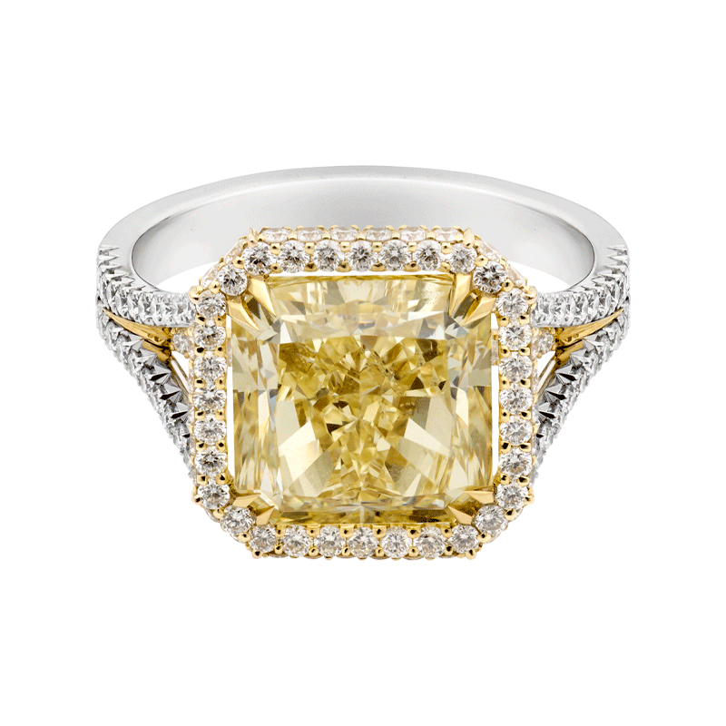 A 5.03ct Natural Fancy Yellow Cushion Cut Diamond Ring