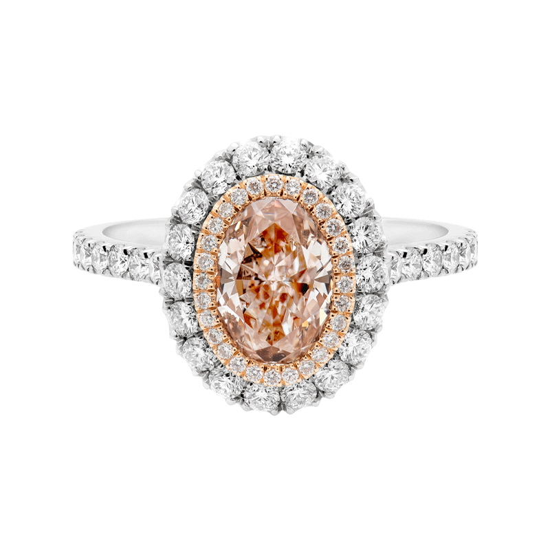 Oval Cut Pink Diamond Ring set with Delicate Diamond Surround