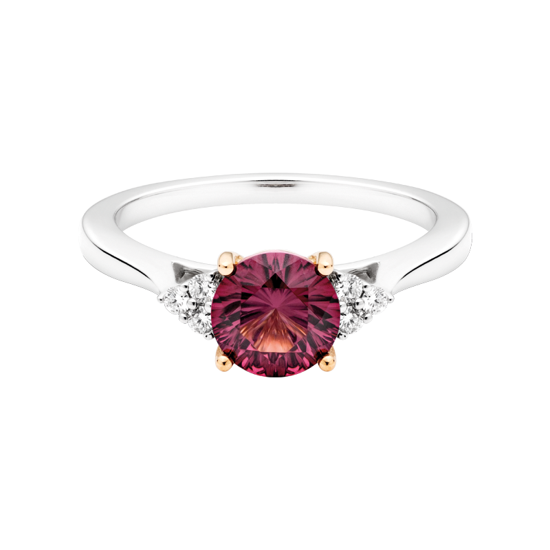 A Round Brilliant Cut Garnet Trilogy Ring