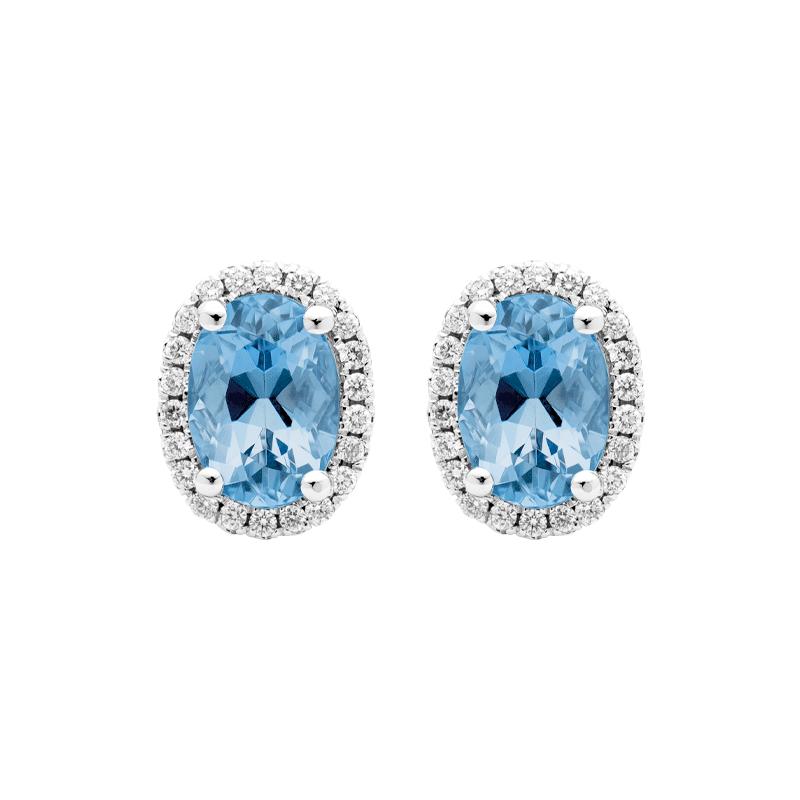 Oval Cut Blue Topaz Stud Earrings